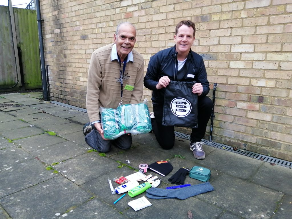 Volunteers Tony and Andy with donated items